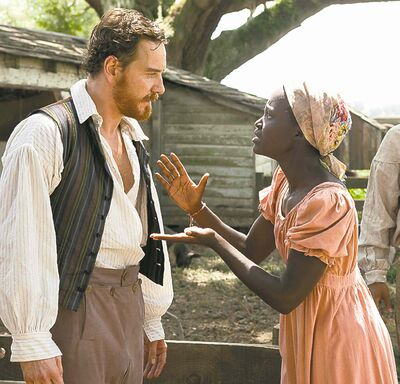 Michael Fassbender as Edwin Epps and Lupita Nyong'o as Patsey from the movie 12 Years a Slave.