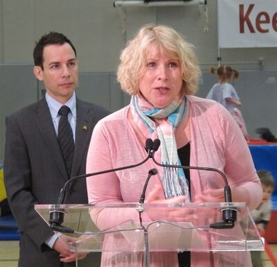 Ontario Health Minister Deb Matthews announces an experts panel aimed at cutting childhood obesity rates in the province by 20 per cent over the next five years in Toronto on Friday, May 18, 2012. Panel co-chair, Alex Munter, CEO of the Children's Hospital of Eastern Ontario, looks on. THE CANADIAN PRESS/Colin Perkel