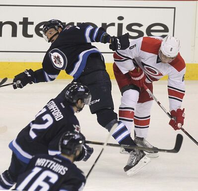 RUTH BONNEVILLE / WINNIPEG FREE PRESS</p><p>Winnipeg Jets Ben Chiarot crashes into Carolina Hurricanes Klas Dahbeck at the MTS Centre Thursday.</p>