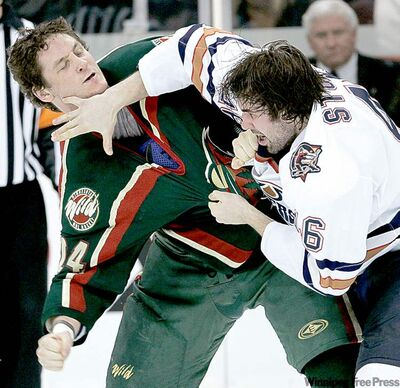 Minnesota Wild's Derek Boogaard, left, dukes it out with Edmonton Oilers' Zack Stortini in 2007.