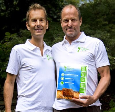 Jeff Golfman and Woody Harrelson appear in this undated handout photo. Harrelson is the front man for a plan to convert agricultural crop waste into paper in Canada. He says making paper from trees is barbaric and he believes using waste from wheat and flax converted into paper could revolutionize the paper industry. THE CANADIAN PRESS/HO - Chris Freeman Henderson