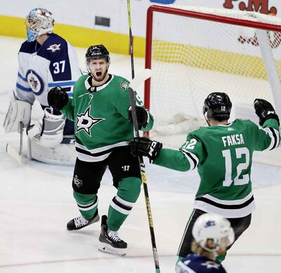 LM OTERO / THE ASSOCIATED PRESS</p><p>Dallas Stars left wing Blake Comeau (15) celebrates with teammate Radek Faksa (12) after scoring a goal against Winnipeg Jets goaltender Connor Hellebuyck (37) during the second period of an NHL hockey game in Dallas, Saturday, Jan. 19, 2019.</p>