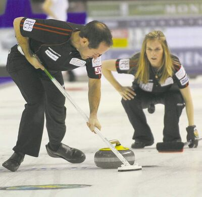 michael burns photo / curling.caJennifer Jones and partner Brent Laing teamed up to defeat Norway�s Torger Nergard and Switzerland�s Carmen Kung 7-5 in mixed doubles.