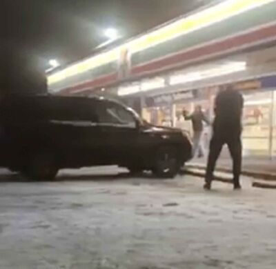 A still image taken from video posted to Facebook showing an officer-involved shooting outside the 7-11 at Arlington and Ellice in Winnipeg Thursday.