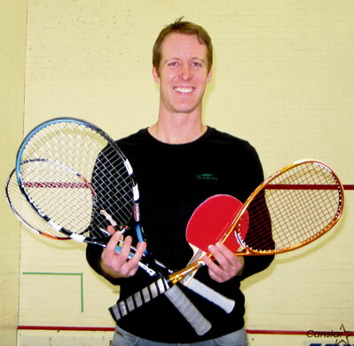 Like any racketlon player, Evan Mancer has his hands full — every match consists of table tennis, badminton, squash and tennis.