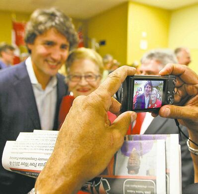 Liberal Leader Justin Trudeau poses for photos in Lorette Wednesday at a rally for Terry Hayward.
