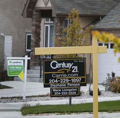 Wayne Glowacki / Winnipeg Free Press </p><p>For Sale signs on houses in Bridgwater Forest. A shrinking supply of available listings is driving up house prices in Winnipeg according to a new report from Royal LePage.</p>