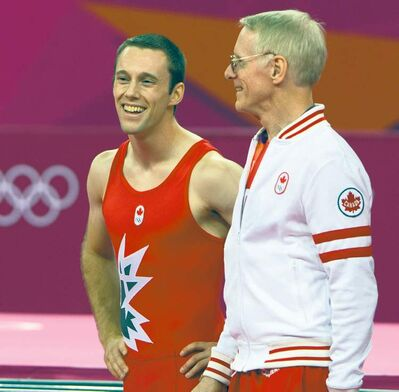 RYAN REMIORZ / THE CANADIAN PRESSCanadian trampoline athlete Jason Burnett chats with his coach, Dave Ross  at the London Games. Executives can also benefit from expert coaching.