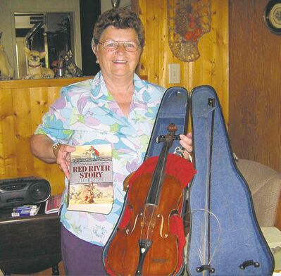 Lynda Jonasson with the violin her grandfather six times removed carried from  the Scottish Highlands to the Red River settlement.