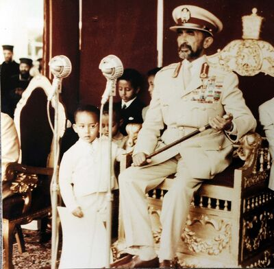 <p>Prince Ermias Sahle Selassie, left, as a boy with his grandfather, the Emperor of Ethiopia Haile Selassie.</p>
