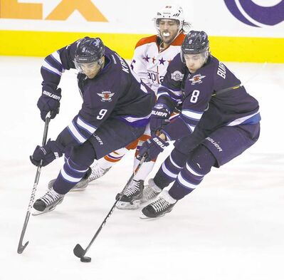 trevor hagan / winnipeg free pressJets Evander Kane (left) and Alexander Burmistrov play the puck in front of the Capitals� Mathieu Perreault Friday. The intensity will continue, the team says.