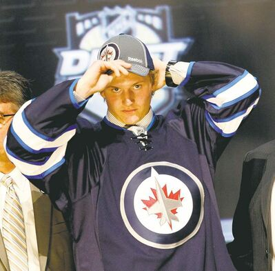 Keith Srakocic / the associated press archivesDefenceman Jacob Trouba dons a Jets outfit last week after the club picked him in the NHL entry draft. He�s expected at the team�s development camp next month.