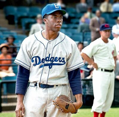 "This film image released by Warner Bros. Pictures shows Chadwick Boseman as Jackie Robinson in a scene from ""42."" The movie, about Robinson�s, life, is bringing his inspiring story to a new generation. Fans young and old can find a number of places in Brooklyn connected to the baseball great. (AP Photo/Warner Bros. Pictures, D. Stevens)"