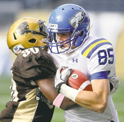 Bison defender Bami Adewale puts a stop to T-bird Alex Morrison's plans.