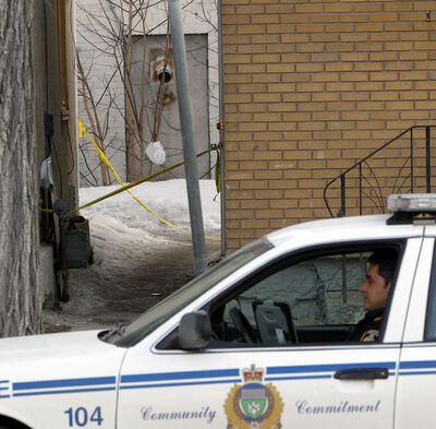 Winnipeg police are at a taped-off scene between two houses in the 500 block of William Avenue.