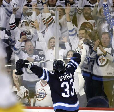 TREVOR HAGAN / THE CANADIAN PRESS FILES</p><p>Fans celebrate after Dustin Byfuglien scored against the Nashville Predators in the second round of the playoffs May 1.</p>