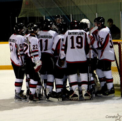 The Westwood Warriors huddle up before their Dec. 8 game against the Stonewall Rams. The Warriors, defending WHSHL champions, are ranked No. 1 in the latest rankings.