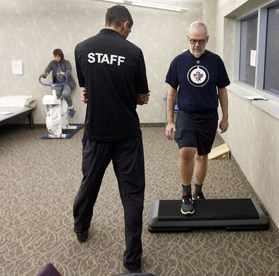 PHIL HOSSACK / WINNIPEG FREE PRESS</p><p>Knee replacement patient Keith Hildahl works the step under the watchfull guidance of Physoitherapist Amandev Dhesi at the Reh-Fit Monday.</p>