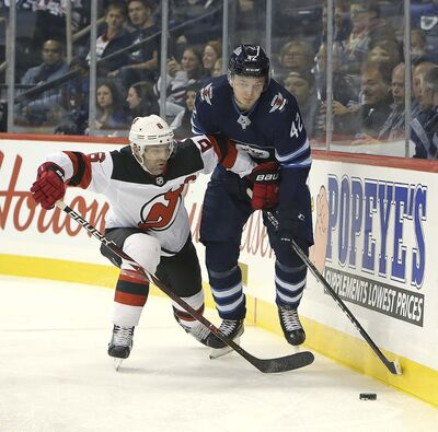 JASON HALSTEAD / THE CANADIAN PRESS FILES</p><p>Winnipeg Jets forward Kristian Vesalainen battles New Jersey Devils defenceman Andy Greene during a pre-season game in Winnipeg Sept. 27. Vesalainen earned his first NHL point on a feed to Brandon Tanev against the St. Louis Blues.