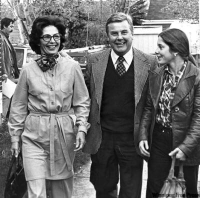 Lyon on his way to vote in 1977 with wife Barbara, daughter Nancy.
