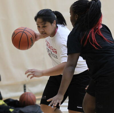 Sisler's Tiara Licsi (left) works against teammate Kyanna Giles during a Tuesday night practice.