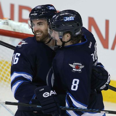 New Jets: Andrew Ladd (16) and Jacob Trouba (8) at the MTS Centre in January 2014.