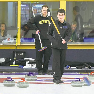 Pembina Curling Club's Scott Duncan, skip for the Carter Wilson team, watches Aaron Anderson Thursday. The MCA is looking at why two clubs do so well attracting young curlers and how to help others.