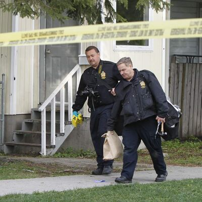 Winnipeg Police officers on the scene at a house in the 500 block of Magnus Avenue.