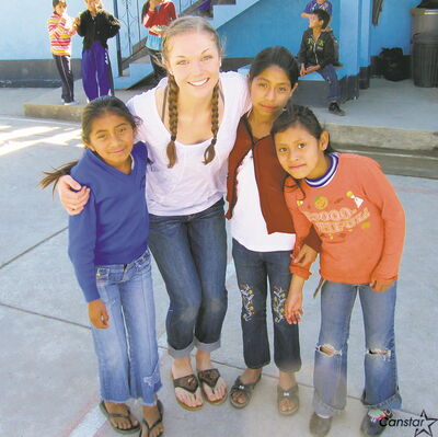 Brooklyn Chambers with some of the children she met while on a Linden Christian School mission to Guatemala.