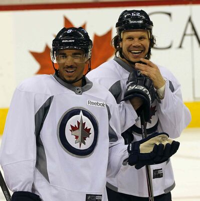 Evander Kane (left) and Olli Jokinen during a break during  the game-day skate in preparation for Wednesday's game against Vancouver Canucks at the MTS Centre.