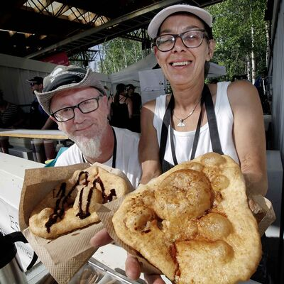 Sharon and Gary Doornsbosch show off the sweet and the savoury Whales Tails. (Phil Hossack / Winnipeg Free Press)