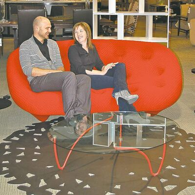 Design Consultant Bradley van Schie and kitchen designer Kim Halpenny on a Ligne Roset settee.