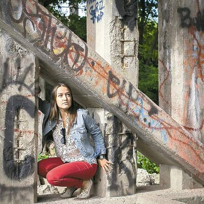 GREG GALLINGER / WINNIPEG FREE PRESS  Breanna Mulhall loves exploring under the railway bridge crossing Omand's Creek, one of her favourite spots in Winnipeg.