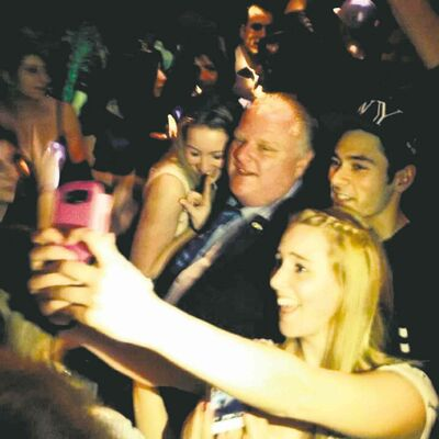 Catriona Korucu / THE CANADIAN PRESS Toronto Mayor Rob Ford poses for photos at the Foggy Dew pub in Coquitlam, B.C., on Friday night.