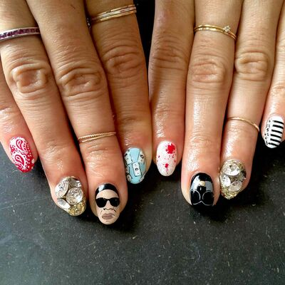 A fingernail design theme for a Jay Z and Beyoncé concert.