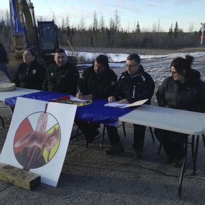 Supplied</p><p>From left to right seated at table: Councillor Shawna Henderson, Councillor Martin Nicholas, Chief Walter Spence, CEO of Manitoba Hydro Kelvin Shepherd and Indigenous Relations Elissa Neville sign agreement.</p>
