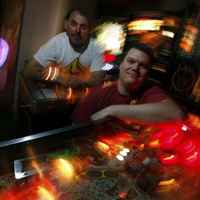 PHOTOS BY PHIL HOSSACK / WINNIPEG FREE PRESS</p><p>David Morris (right) and Mark Jaslowski get a kick out of watching people of all ages enjoy themselves at their pinball popup, Flipping Out at The Forks.</p>