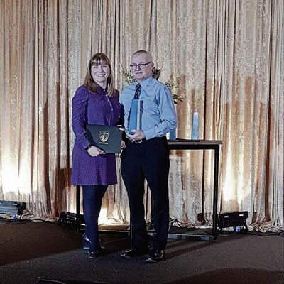 Gary van der Zweep, academic co-ordinator at Red River College's Stevenson campus – Aviation and Aerospace, is shown receiving the Instructor of the Year Apprenticeship Award of Distinction from Colleen Kachulak, acting assistant deputy minister, Post-Secondary Education and Workforce Development, Manitoba Education and Training.