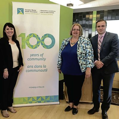 From left: Marion Cooper, CMHA executive director; Debra Radi, CMHA chairperson; and Evan Johnston, senior vice president and chief legal officer, The Wawanesa Mutual Insurance Company. Wawanesa presented CMHA with $100,000 in celebration of their 100th anniversary.