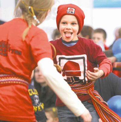Photos by Ruth Bonneville / Winnipeg Free Press Caleb Arnaud, 6,  dances with his sister, Katherine, to the music of the Bart House Band inside the Sugar Shack Saturday. It was the first full day of the 45th annual Festival du Voyageur.