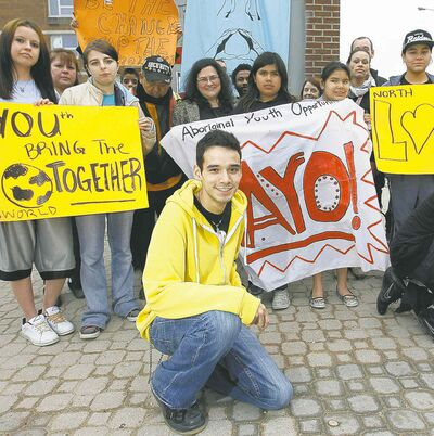 Michael Champagne (front) leads a rally against violence at the bell tower on Selkirk Avenue in 2012.