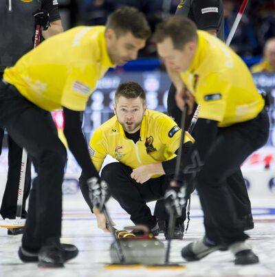 THE CANADIAN PRESS/Adrian Wyld</p><p>Skip Mike McEwen, from Winnipeg watches his rock as second Matt Wozniak(left) and lead Denni Neufeld sweep during Olympic curling trials action against Team Koe, Tuesday December 5, 2017 in Ottawa. </p>