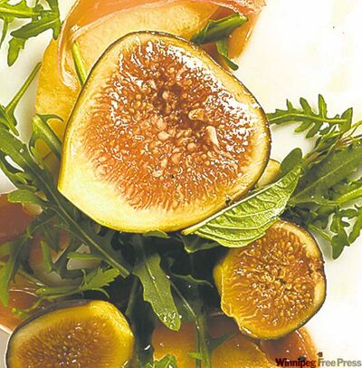 Arugula with heirloom melon slices, ripe figs and prosciutto.