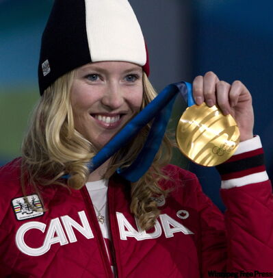 Ski-cross gold medalist Canadian Ashleigh McIvor holds up her gold medal Tuesday during the medals ceremony.