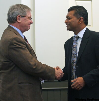 University of Winnipeg President and Vice-Chancellor Dr. Lloyd Axworthy, left, and Cisco Canada President Nitin Kawale announce the partnership.