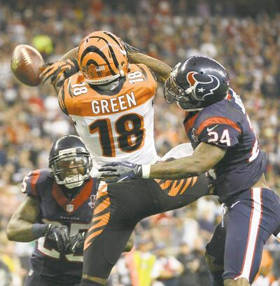 George Bridges / MCTJohnathan Joseph (24) of the Houston Texans gets a hand out in time to knock away a pass intended for A.J. Green of the Cincinnati Bengals.