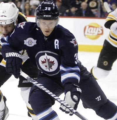 Winnipeg Jets' Tobias Enstrom (39) will have an MRI on his shoulder after being injured in the first few minutes of Friday's loss to the Pittsburgh Penguins.