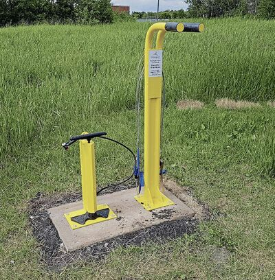 The new, public bicycle repair stand on Bishop Grandin Greenway will be a handy addition for cyclists who need to make quick, on-the-fly repairs.