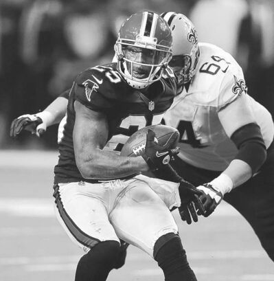 curtis compton / the associated pressFalcons� William Moore snags one of five picks thrown by Saints� Drew Brees.