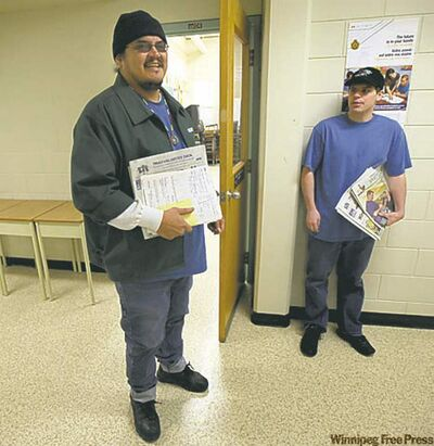 Stony Mountain inmates, left to right, Fabian Twohearts and  Jeremy Garton pause in a hallway in the prison school.